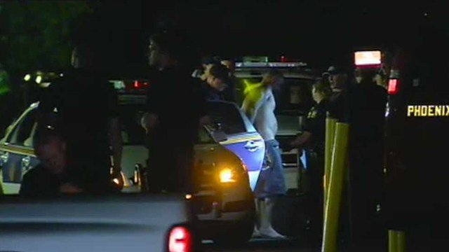 Phoenix police take a man into custody after he barricaded himself in his ex-girlfriend's apartment. (Source: CBS 5 News)