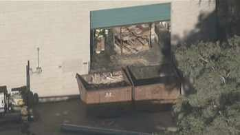 © Warehouse fire at 7700 W. Olive Ave.
