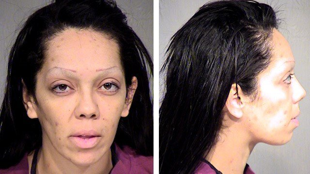 Corina Ann Martinez is facing a possible felony charge of animal cruelty after an emaciated and weakened dog was found hanging from a door knob with only its back legs touching the floor in  an apartment. (Source: Maricopa County Sheriff's Office)