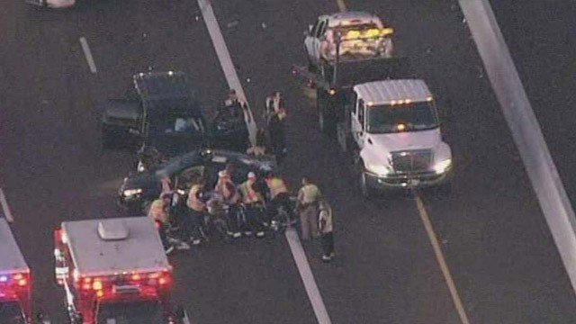 Emergency personnel work on injured motorists after a crash on northbound State Route 51 on Thursday morning. (Source: CBS 5 News)