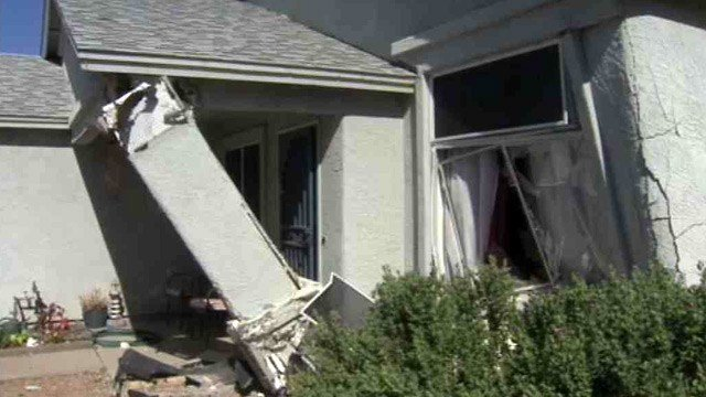 A man lost control of his car and ran into the front of this Phoenix house Friday morning. (Source: CBS 5 News)