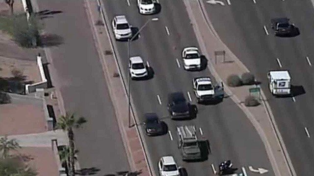 Traffic on eastbound Shea Boulevard in Scottsdale was restricted while police removed two horses that were struck and killed. (Source: CBS 5 News)