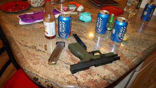 A .40-caliber handgun sits on a kitchen counter at a residence in Florence after it discharged and the bullet struck and killed a man. (Source: Pinal County Sheriff's Office)
