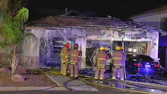 Two cars were destroyed and another damaged by this garage fire in Peoria on Wednesday morning. The family got out safely. (Source:CBS 5 News)