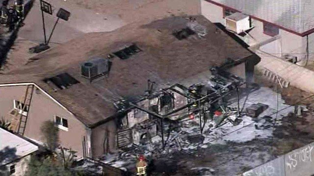 Phoenix firefighters found ammunition inside this burning home Friday afternoon. (Source: CBS 5 News)
