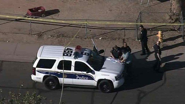 Police investigate the scene of a fatal shooting Friday afternoon in south Phoenix. (Source: CBS 5 News)