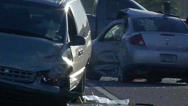 The driver of the passenger car in the background was killed in a collision with a minivan in Phoenix early Monday. (Source: CBS 5 News)