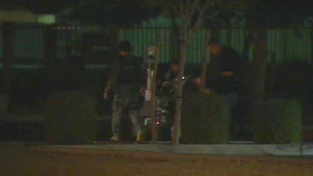 Mesa police use a robot to check out a suspicious box found in a planter Monday night. (Source: CBS 5 News)