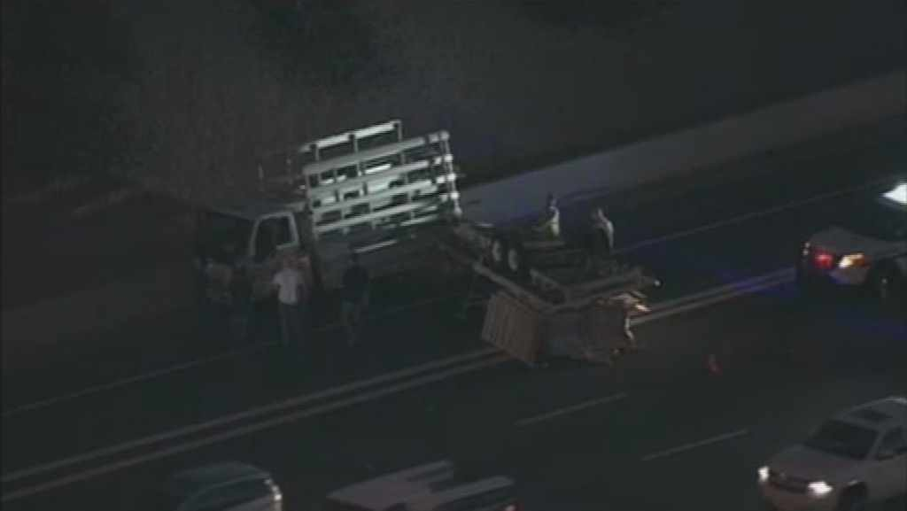 This overturned utility trailer caused a massive backup on U.S. 60 in Mesa Tuesday morning. (Source: CBS 5 News)