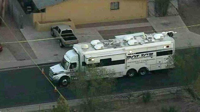 A mobile Mesa police command center sits near the scene of a fatal shooting in Mesa. (Source: CBS 5 News)