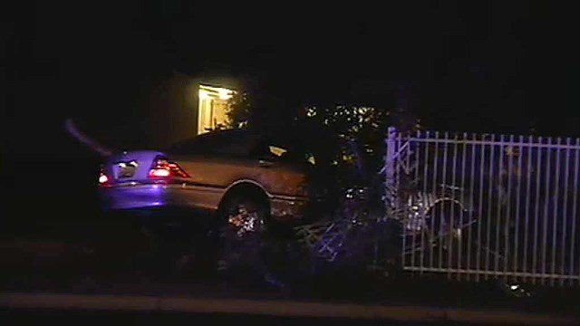 A man suffering from a gunshot wound was found in this Mercedes early Wednesday morning. (Source: CBS 5 News)