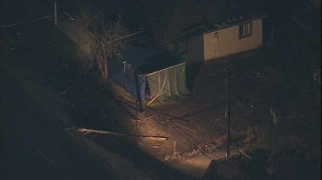 A pole lies on the ground after it was hit by a car in Glendale on Monday morning. (Source: CBS 5 News)