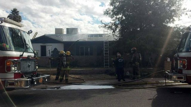 Phoenix firefighters work a house fire in the northern part of the city Thursday morning. (Source: CBS 5 News)