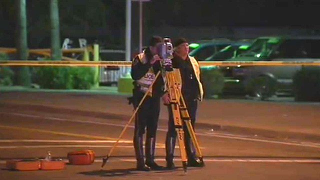 Chandler police officers investigate the scene where a boy was struck and killed while crossing a Chandler street Monday night. (Source: CBS 5 News)