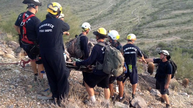 Rescuers carry a 17-year-old boy down Piestewa Peak after he fell and hurt a leg while hiking. (Source: Phoenix Fire Department)