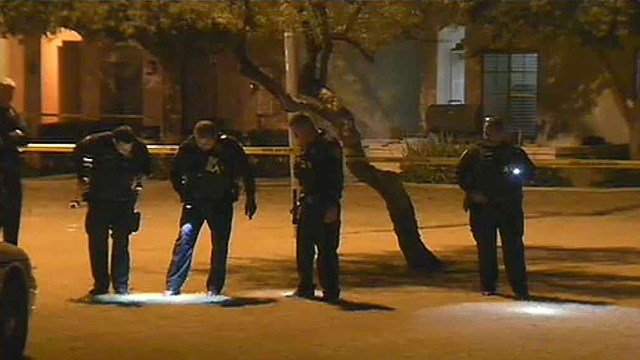 Chandler police officers comb the area of a shooting early Wednesday morning. (Source: CBS 5 News)