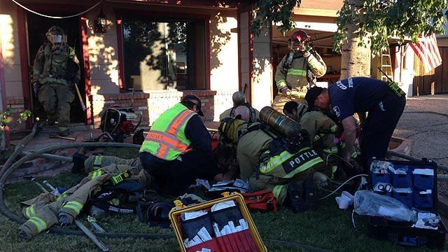 Glendale firefighters work frantically to save a dog that was dragged from a house fire Sunday afternoon. (Source: Glendale Fire Department)