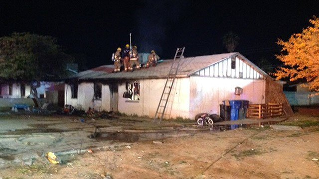 Phoenix firefighters attack a house fire early Wednesday morning that left five people without a home. (Source: Phoenix Fire Department)