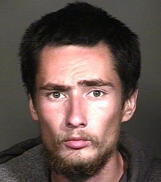 Curtis Phillip Archer told officers he was being chased by a person with a shotgun and that he was looking for a place to hide, and also admitted smoking meth earlier in the evening. (Source: Mesa Police Department)