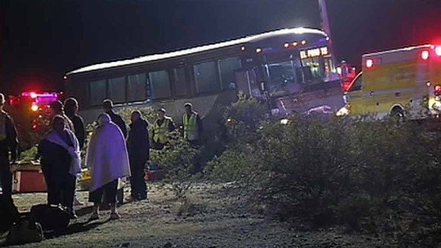 Passengers wait outside a Greyhound bus after its driver brought it to halt when two passengers attacked him outside of Tonopah early Thursday morning. (Source: CBS 5 News)