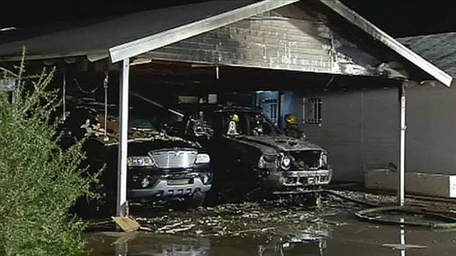 A pickup truck and SUV were destroyed in a Scottsdale carport fire. (Source: CBS 5 News)
