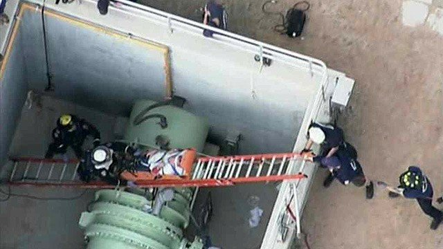 Scottsdale fire Capt. Danny Able said the worker was in a 20-foot concrete vault and fell about five feet from atop the pipe. (Source: CBS 5 News)