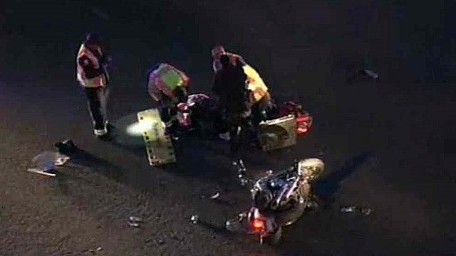 Emergency crews treat a motorcyclist hurt in a Friday morning crash. (Source: CBS 5 News)