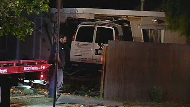 Phoenix police said the driver of this van appeared to be intoxicated after it slammed into a home early Tuesday morning. (Source: CBS 5 News)