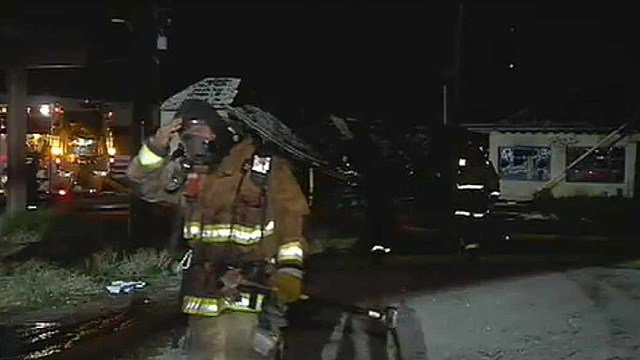 Firefighters begin to walk away from an empty warehouse destroyed by fire early Wednesday morning. (Source: CBS 5 News)