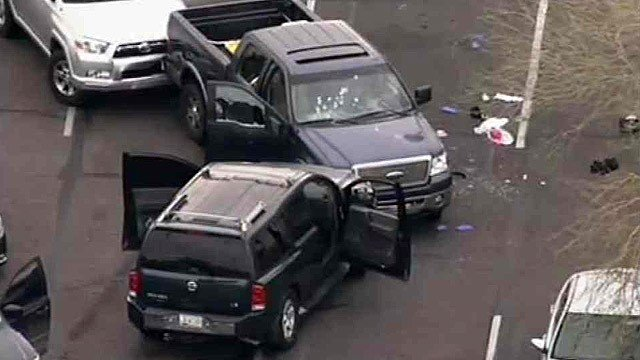 A pickup truck and SUV show signs of an officer-involved shooting in Glendale on Thursday morning. (Source: CBS 5 News)