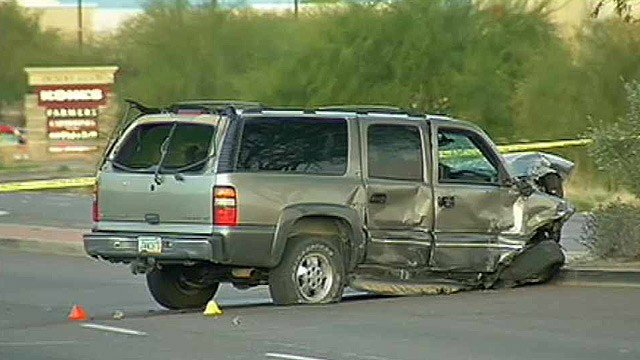 The driver of this Suburban was believed to have been going about 80 mph when it slammed into a car at a Phoenix intersection Tuesday morning. (Source: CBS 5 News)