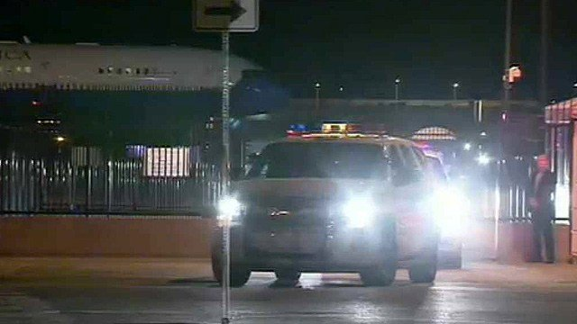 A Phoenix police cruiser leads a motorcade for Vice President Joe Biden from Phoenix Sky Harbor International Airport just after midnight Friday morning. (Source: CBS 5 News)
