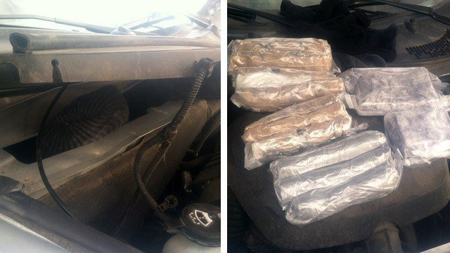 A Pinal County deputy said he found sock bundles containing 5.8 pounds of methamphetamines and 3.7 pounds of cocaine in the firewall of a vehicle Monday. (Source: Pinal County Sheriff's Office)