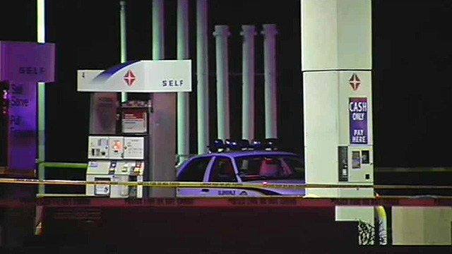 A Glendale police car sits in the parking lot of an ampm store after a deadly shooting. (Source: CBS 5 News)
