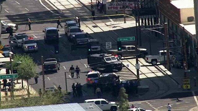 A carjacking suspect was shot and killed by police in downtown Phoenix late Tuesday morning. (Source: CBS 5 News)