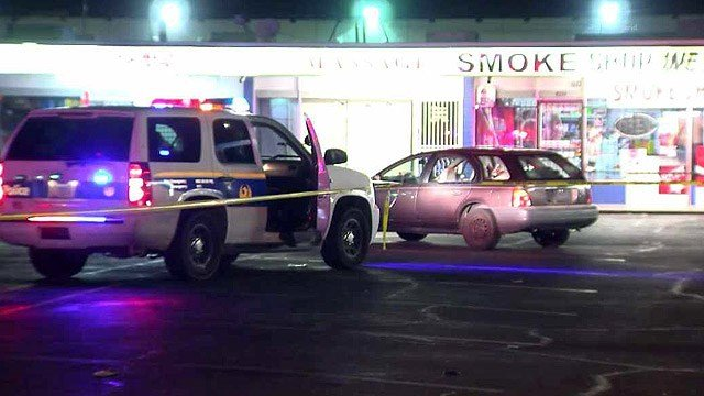 Two men were shot, one fatally, while the stood in the parking lot of this Phoenix shopping center Thursday night. (Source: CBS 5 News)