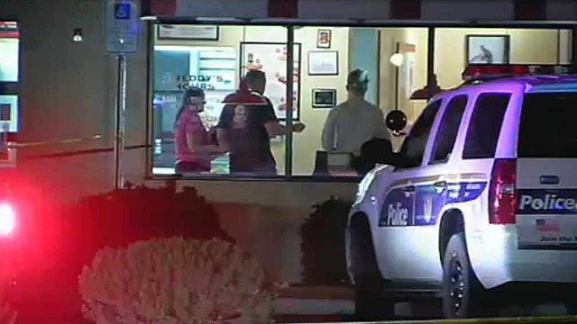 Phoenix police investigators comb the scene where a police officer shot a man with a stun gun on Sunday night. The man died shortly after in a Phoenix hospital. (Source: CBS 5 News)