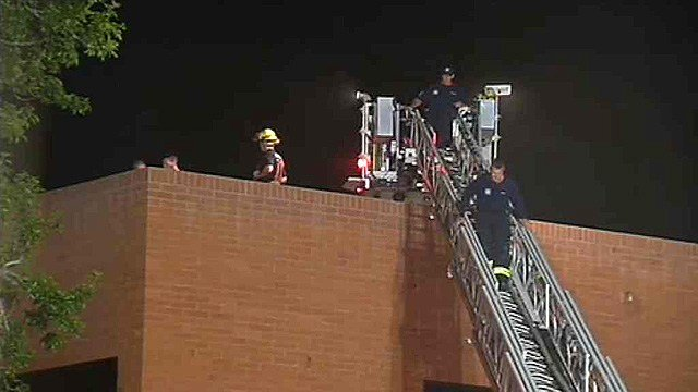 "Phoenix firefighters cut a hole in the roof of this business building to ventilate smoke from a fire they called ""suspicious"" Thursday night. (Source: CBS 5 News)"