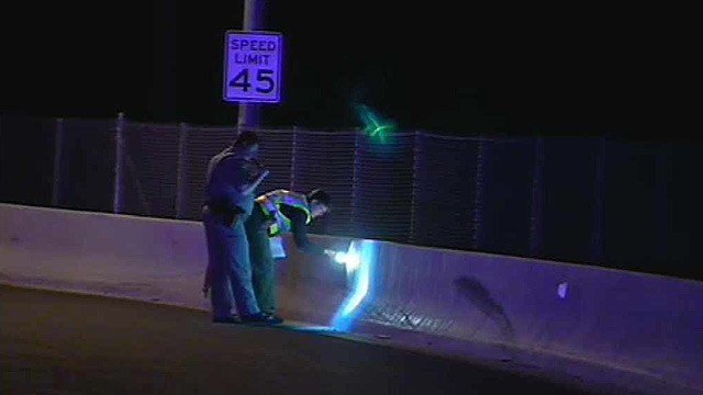 DPS officers search the scene of a fatal head-on collision on the Beeline Highway on Thursday night. (Source: CBS 5 News)