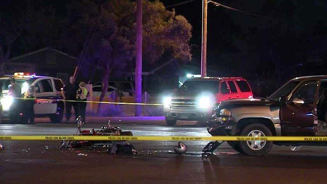 A motorcyclist died after colliding with this SUV at a Phoenix intersection Thursday night. (Source: CBS 5 News)