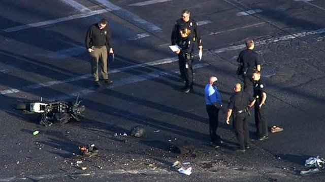 Phoenix police at the scene where a motorcyclist collided with the semi about 5:30 a.m. at the intersection of 27th Avenue and Durango Street. The motorcyclist later died. (Source: CBS 5 News)