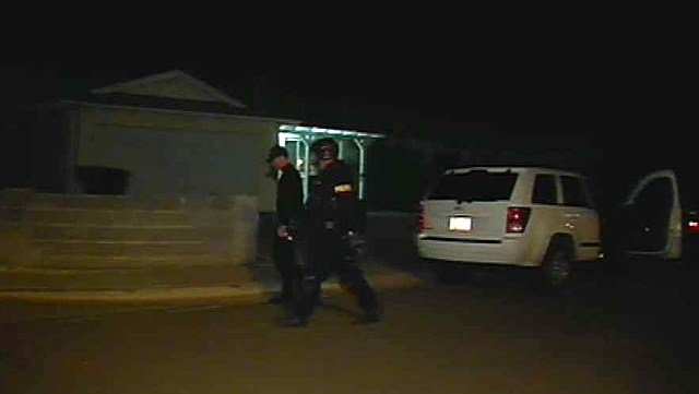 Phoenix police officers leave the scene of a standoff with a former Maricopa County sheriff's deputy early Monday morning. (Source: CBS 5 News)
