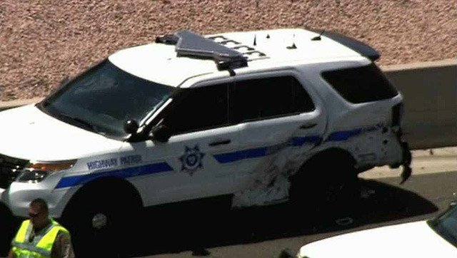The DPS vehicle was damaged and the officer injured, though not seriously. (Source: CBS 5 News)