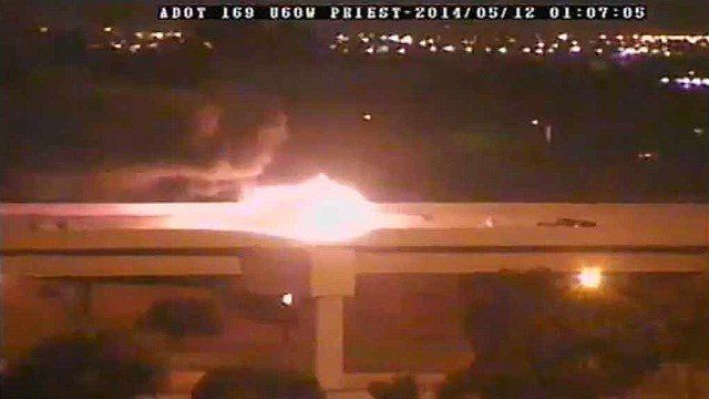 An Arizona Department of Transportation traffic camera shows the fiery scene of a head-on crash that killed a driver and an off-duty Mesa police officer. (Source: Arizona Department of Transportation)