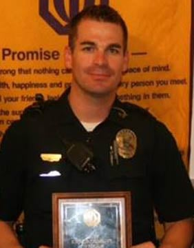 Officer Brandon Mendoza after accepting the 2013 Officer of the Year Award from the Mesa Optimist Club. (Source: Mesa Police Department)