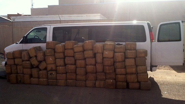 A Pinal County sheriff's deputy found this load of pot estimated to be worth more than $1.3 million in this large passenger van. Two men seen by the van were later arrested. (Source: Pinal County Sheriff's Office)