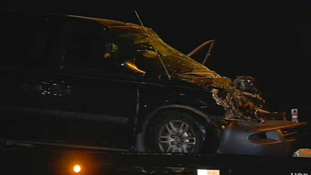 The woman driving this minivan was in serious condition after driving through a stop sign and colliding with a semi on Loop 303 in the West Valley. (Source: CBS 5 News)