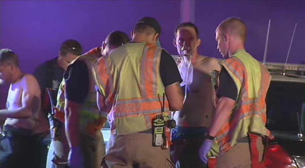 Firefighters attend to two of the residents of a Mesa apartment who suffered smoke inhalation during a fire Wednesday night. (Source: CBS 5 News)