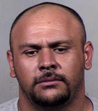 Juan Ramon Flores, 33, was arrested about 8 a.m. Thursday and jailed on 10 counts of sexual exploitation of a minor. (Source: Maricopa County Sheriff's Office)