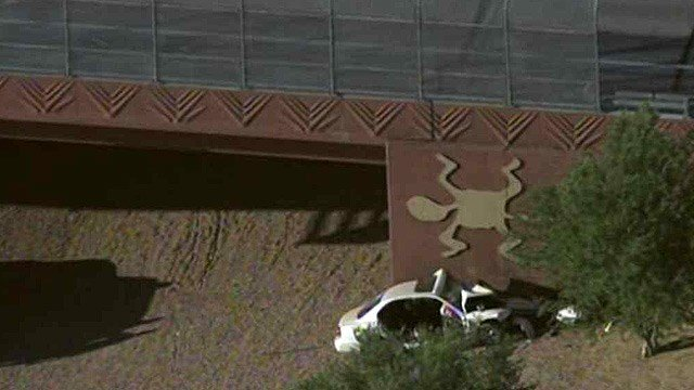 The driver of a passenger car was killed when the vehicle left an East Valley freeway and collided head-on with the concrete wall of an overpass in Mesa. (Source: CBS 5 News)